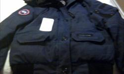 CANADA GOOSE JACKET NAVY BLUE ! AS IS CAN STILL BE USED FOR A COUPLE MORE GOOD WINTER SEASONS , JUST NEEDS A BIT OF TLC! :) ASKING 120.00 Feel Free To Contact Me ALSO HAS AUTHENTIC CERTIFIED TAG! It has been used for about one winter season ! It is a Size