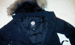 Brand new Woman's Kensington Parka. Received as a Christmas gift, and cannot be returned. Still with original tags. Never been worn. Asking $525 or best offer. Black. Size Medium. Duck down. Coyote fur hood.