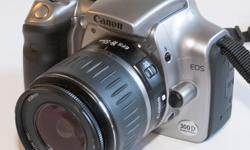6 mega pix 300d eos rebel ,battery and charger usb adapter,2gig cf card. 28-80mm ef lense ..