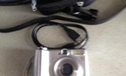This digital camera is in excellent condition...comes with original box and usb charging cable and carrying pouch...works with 2 AA batteries... p.s.: 613-618-5554 (Michel)