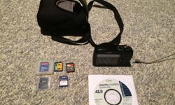 Selling camera, case, software, instructions & memory cards (1x 8GB, 1x 512MB, 2x 256MB & 1x 128MB).