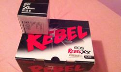 -canon rebel xs with kit lens, canon 50mm 1.8 lens and SDHC card -used but comes with everything originally in box (charger, strap, caps, usb + video cord - not in pic, battery, battery case, etc) -SHUTTER COUNT LESS THAN 5k!!! -excellent for beginners