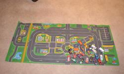 """Car mat measuring 24 by 56"""" with 25 used cars."""