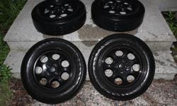 A full set of rims and tires from a 2005 Mini Cooper. SIze - 175/65/R15 Bolt Pattern is 4 x 100 These original mini rims would make a great set of winter rims. Presently have Continentals summer tires on the rims.