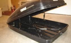 Thule car top carrier.  mounting hardware.$75.00 or best offer.