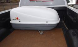 18.5 cubic foot locking Car Top Carrrier used once only.  Comes with keys, and tie down straps.  Size is 46 L,  32 W,  17 H, 20 H. Call Don at (807) 577-6597