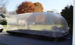 """20' CarCapsule Tall Indoor(Length x Width x Height)20' x 78"""" x 80"""" NEW IT WAS $400. Price $250. The Car Capsule is a clear vinyl bubble that seals your car, truck, boat or motorcycle completely away from the elements. Dust, dirt, condensation, even"""