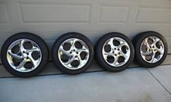 Mint condition chrome rims from a 2002 Chevy Cavalier, Summer Tires only! Tires have 45,000 KM on them. They were purchased brand new in 2003. Never saw snow or ICE stored in a Garage from October to May yearly. Recently sold the car no need for second