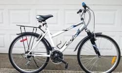 """CCM Elipse Ladies Hybrid Bicycle - 18"""" Aluminum frame for riders 5'5-5'0 in height - 26"""" x 1.50 hybrid cruise style tires with full air - Simple 21 speed with Shimano grip shifting - Recycled and ready for you to re use once again - Comes with rain"""