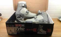 CCM Tyke expandable skates, expand 3-4 sizes so they grow with your child. Size medium, fits 11-13 youth. Durable molded plastic shell. Comfortable padded liner. Convenient 2 buckle closure. Excellent condition.