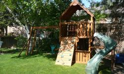 Great fun for your kids! Includes a regular swing, acrobatic swing, glider swing, rock climbing wall, slide, clubhouse, & picnic table. Size 12' x 20' (24' x 32' with safety clearance) 1-2x4 along bottom must be replaced due to moisture damage.