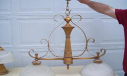"""Newer ceiling light fixture with two etched glass shades. Excellent condition The base is an antiqued gold colour.  Measures approximately 33"""" wide and hangs approximately 34 - 36"""" from the ceiling   Please phone number listed under Poster Contact"""