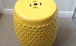 Yellow ceramic stool that can be a beautiful and useful addition in a living room, bedroom or anywhere around the house. Great for outdoors too. Great condition! No cracks or scratches.