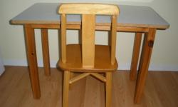 Solid hardwood chair and arborite table (wipes easily of crayon, paint, marker). Table frame and legs are pine.