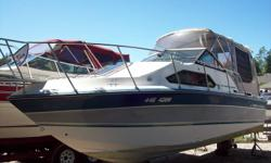 23 feet (LOA 26?).   Cuddy cabin, aft cabin, separate galley/shower, shore power.  Safety equipment, lines, 2 depth finders and radio equipment included.  Alcohol/electric stove, dual refrigerator.  5.7 L V8 (350hp) w/all maintenance by Huron Shores