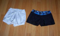 1 pair silver metallic - size XS; 1 pair black with metallic blue plaid waistband with matching cheer on the bum - size 2 (fits XS); $10 for both
