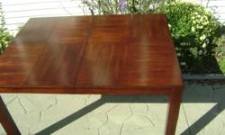 """FOR SALE - REAL DEAL   42"""" x 54"""" Cherry dining room table with 18"""" leaf & 6 leatherette padded black chairs. About three years old rarely used. Paid $1400.00 - asking 750.00 o.b.o"""