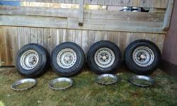4xP235/75 16 dayton timberline tires 4xChev Rally Rims with centres & trim rings