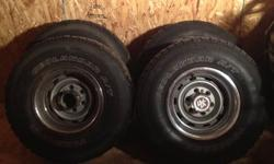 Stock rally wheels off of 1986 chev 4x4 they come with center caps and trim rings and yokohama geolander tires