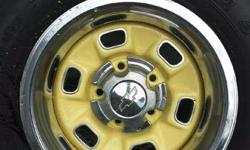 14 inch rally rims complete with center caps,trim rings and stainless steel slot inserts,comes with 2 P245/60R14 and 2 P235/60R14 new tires. also have set of 14 inch Olds rally rims Open to Offers misc trim rings and center caps new SSR car cover still in