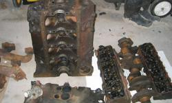 350 Chevy engine 4 bolt mains for rebuild , plus 350 turbo-hydramatic transmission and other related parts .