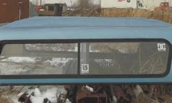 blue 8' truck topper sliding side & rear windows $300.00 obo. 622-2594