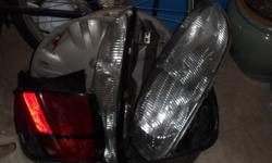 A basket of misc parts for 1999 Chev Lumina. Headlights, rear lights, a couple of hubcaps, rear light panel, washer fluid jug. $40 OBO If the ad is still showing then the items are still available.