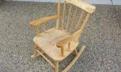 """Wooden rocking chair. Solid Wood (not sure what kind). Dimensions: 24"""" high at back, 11.5"""" high to seat. Seat is about 14""""x13"""". Good condition although it needs to be refinished. [Note: for safety reasons it would be prudent not to let very young children"""