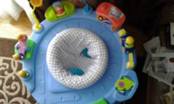 Used child's exersaucer that doubles as a car toy after baby is done with it.