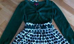 Very cute matching outfit in excellent condition. Skirt is a size 5 and sweater is a size 7/8.