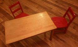 Children's solid wood table and chair set. 36 inches wide, 19.5 inches deep and 21 inches tall. Comes with 2 red chairs. Asking $45
