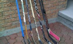Several children's street hockey sticks and goalie stick Left handed, Right handed, some with straight blade (suitable for R or L handed shooters) There are more sticks than are shown in this picture. Adult sticks also available. $5 - $10 each $20 for