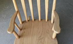 Rocking chairs are made entirely  of solid oak.Have one of each in stock.