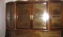 Are you still looking for a gift for the woman in your life?   I have a beautiful china cabinet for sale.  It is hand made by a wonderful carpenter who unfortunately is no longer with us, but each piece he did was one of a kind and made with love as the