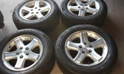 These Dodge factory rims were on a 2004 Intrepid. These rims are in excellent condition with some minor scuffs/scratches.  The tires on the rims are throw aways, as they are quite worn.   The price is $220. firm.   2004 Dodge Intrepid Bolt Pattern: