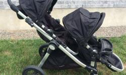 Baby Jogger City Select double stroller in black. EUC. Comes with the following: - two seats - one car seat adapter (we used it with a Chicco Keyfit but I'm pretty sure it's the universal model that works with most car seats) - one snack tray (it's just