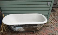 5 ft long, 22 in high cast iron tub.