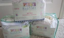-Three packs of 5 newborn (4-10lbs) Kushies cloth diapers -14 cloth diapers that are one size larger than the Kushies with liners and plastic covers