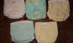 These are in good condition. They are flannel and have separate covers. likely fit 10-40lbs?. Pics are not of actual diapers. Just to show what they look like. Asking $25.