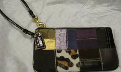 90% new - with dust bag (used few times only) 100% Authentic Coach small wristler with strap attached Cool colour, special pattern, special gift for your love one!! Perfect for Christmas, Birthday or Suprise gift!