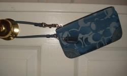 Coach wristlet in Perfect condition. *I will delete ad once it's sold.