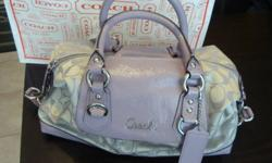 Coach signature lilac handbag brand new with tags and bag retails for $298 +tax selling for $200 bought for Girlfriend as a gift but she left with the receipt , can't return to store Absolutely exquisite!!! 100% authentic white and lilac Coach handbag. 2