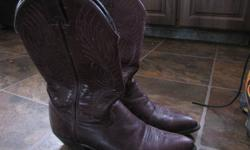 I only wore these boots one year, but didn't want to part with them, hoping my feet would fit into them again! In excellent shape; grape in color. $15.00 firm 862-9193