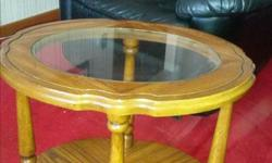 Beautiful coffee and end tables; $200 or best offer. Phone number is long distance; may also text to 403-360-4779.
