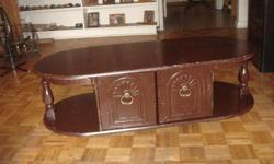 coffee and end tables-4 years old, bought at the brick, contemporary, coffee table has doors in the middle with open storage on the sides, end tables have storage underneath, behind two doors, coffee table is 50 inches long, 13 inches height, 22 inches in