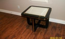 3 black tables with GLASS & gold trim @$40.00 FOR SMALL AND $100.00 FOR LARGE and 1 circular Teak glass table @ $100.