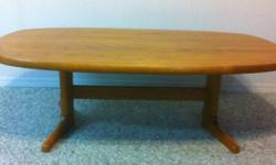 Solid Teak oval coffee table. Good condition. This ad was posted with the Kijiji Classifieds app.
