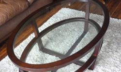 Oval glass coffee table and two matching circular end tables for sale. Each has one glass shelf underneath.   Coffee table dimensions: 3? 10? long x 2? 6? wide x 1? 6? high  Circular end table dimensions         1? 6? diameter         2? 4? high