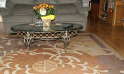 Very heavy & classy tables. Solid wrought iron with tempered glass tops. Excellent condition. Smoke free home.  Email or call Kevin.