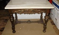 "Old mahogany base with added marble top. Base 24""W 16""D Top 27""W 18""D 48"